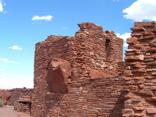 Camp at Wupatki National Monument, start a fire, climb on ruins, and bring bail money.   Hopefully the hippie is an attorney.